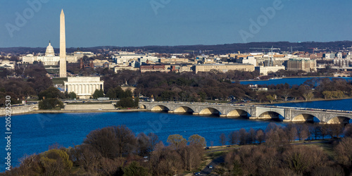 Fototapeta Washington D.C. . - Aerial view of Washington D.C. from Top of Town restaurant, Arlington, Virginia shows Lincoln & Washington Memorial and U.S. Capitol with tour boat and Potomac River in foreground obraz