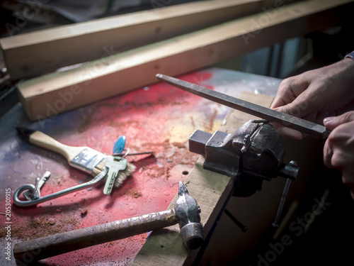 Fotografie, Obraz  close up master crafting keys in the workshop
