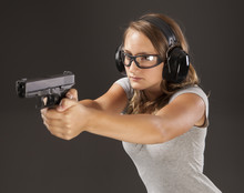 Young Female Shooter Taking Pr...