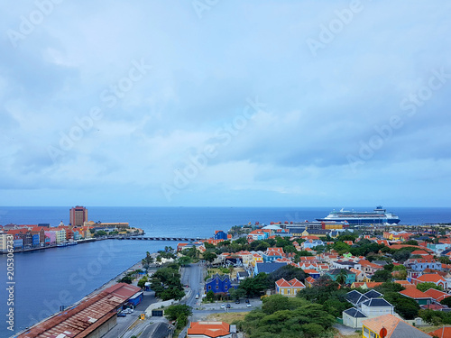 aerial view of the coastline city of Willemstad, capital of Curazao, with colorful buildings and blue sea and sky Canvas Print