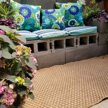 Cinder Block Patio Bench With Colorful Summer Print Pillow With Begonia Plant And Ferns