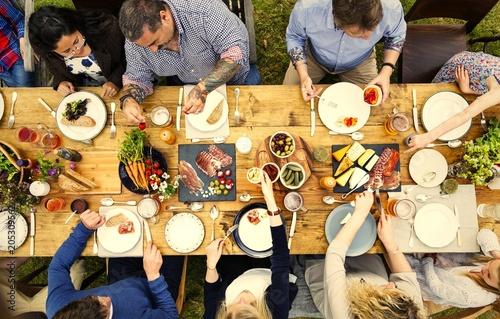 Foto op Canvas Kruidenierswinkel Friends enjoying a dinner in the garden