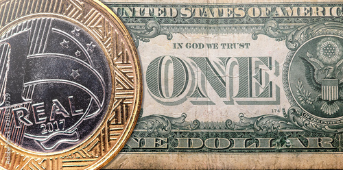 One Brazilian Real Coin Overlaped On A Us American Dollar Bill Exchange Rate And Economy Concept Idea