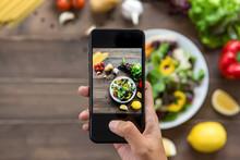Food Blogger Using Smartphone Taking Photo Of Beautiful Salad