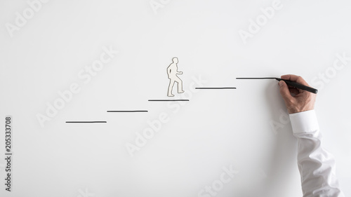 Fotografie, Obraz  Paper silhouette cutout of a man and a businessman drawing steps