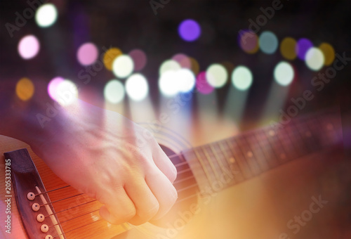 Valokuvatapetti Double exposure of Colored bokeh with concert light image and male hand playing on acoustic guitar