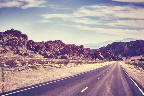 Photo Stands Eggplant Retro toned desert road, travel concept, Valley of Fire; Nevada, USA.
