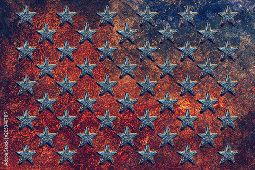 Fotografering  Embossed USA star shapes on rusty metal surface