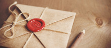 Love Letter In A Craft Envelope With A Sealing Wax Seal In The Form Of A Heart On A Wooden Background. Free Space