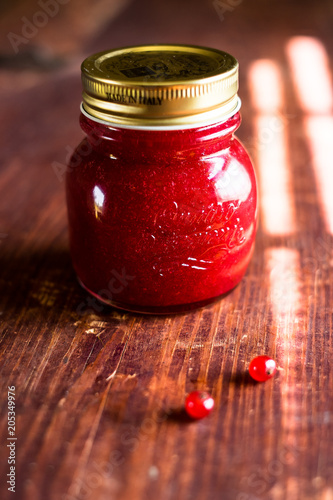 Foto op Canvas Buffet, Bar Jar of freshly made red currant jelly jam or sauce on a wooden table, selective focus. Image with copy space. Rustic style.