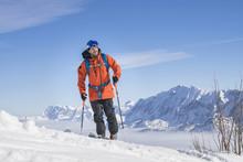 Skier Climbing Snow Mountain I...