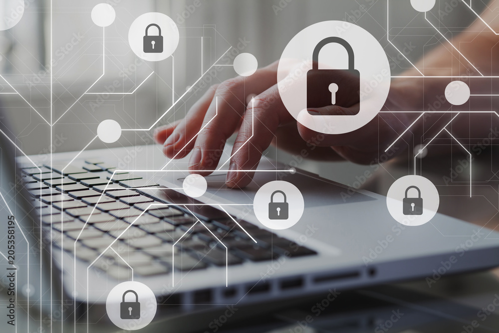 Fototapeta Cyber internet security concept. GDPR and cybersecurity. Protection of private personal data. A person using internet on laptop on the background.