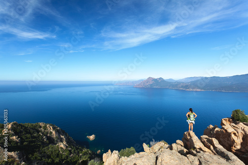 Poster Europa Hiker looking at the view at Calanques de Piana in Corsica, France