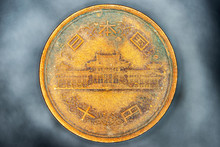 Old Chinese Coin On Blured Bac...
