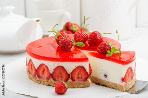 Fényképezés  Cold cheesecake with strawberry and strawberry jelly.