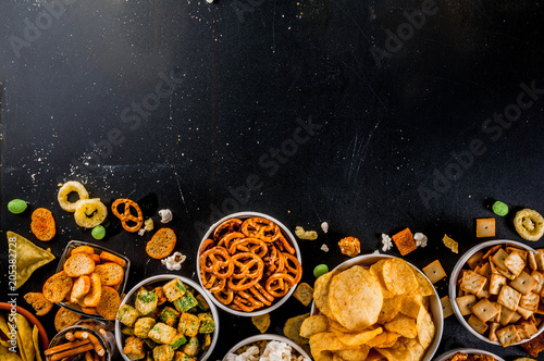 Fotomural Variation different unhealthy snacks crackers, sweet salted popcorn, tortillas,