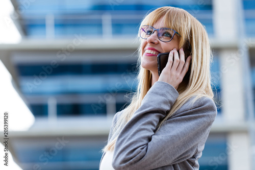 Young beautiful woman talking on phone