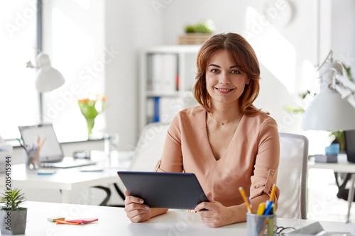 Poster Vissen business, technology and people concept - businesswoman with tablet pc computer working at office