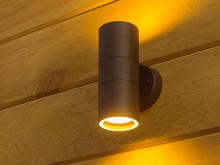 Outdoor Exterior Small Cylinder Lamp On Wooden Wall. External Illumination