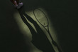 Tennis competition concept shadow of Woman holding racket playing tennis