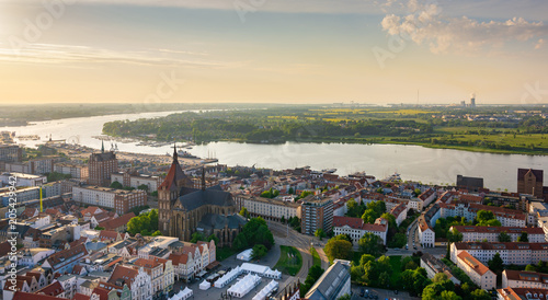 Montage in der Fensternische Budapest aerial view of rostock, germany in the evening - river warnow in the background