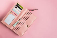 Open Female Pink Wallet. Flat Lay. Copy Space.