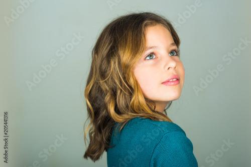 741502a40 Cute little baby girl fashion pretty model dark blonde curly lady hair  funny child birthday party
