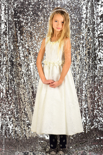 fce188335630 Look, hairdresser, makeup. Fashion model on silver background, beauty. Child  girl in stylish glamour dress, elegance. Little girl in fashionable dress,  ...