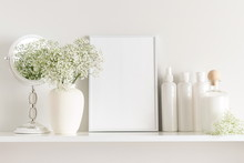 Cosmetic Set On Light Dressing Table.Beautiful Flowers In A Vase On A White Wall Background, Mirror On A Wooden Shelf.
