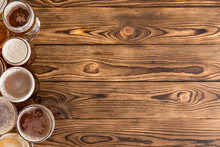 Frothy Pints Of Beer On Timber Bar With Copy Space