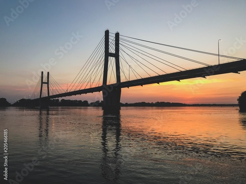 Fototapeta Suspension Bridge at Sunset over Mississippi River