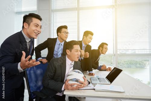 Fotobehang Stof Asian Businessman Watching Football Match