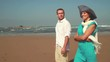 Couple in love talking and walking on the beach, steadicam shot HD