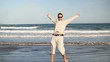 Ecstatic man running and jumping on the beach, slow motion HD
