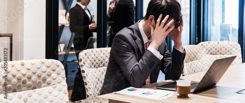 Troubled young businessman. Canvas Print