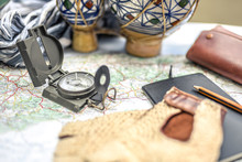 Objects From An Adventurous Journey. Map, Compass, Notebook, All Ready For A New Adventure In The Desert, A Travel To Remember For A Life, Discovering New Lands In Wild And Unexplored Locations