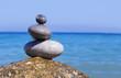 Spa stones balance on beach .