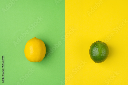 Ripe Organic Lemon and Lime on Split Duotone Green Yellow Background. Styled Creative Image. Citrus Fruits Vitamins Summer Vegan Fashion Concept. Food Poster with Copy Space