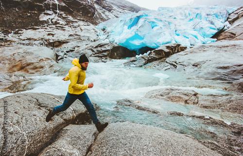 Fotografie, Obraz Running Man in glacier mountains travel adventure active healthy lifestyle endur