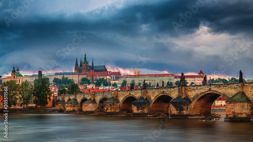 Foto op Plexiglas Japan Prague Castle and the Charles Bridge at sunset in Prague, Czech Republic, Vltava river in foreground