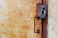 Old Rusty Iron Door With Padlock And Handle, Side View Close-up