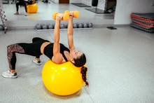 Girl Exercising On Yellow Gym ...