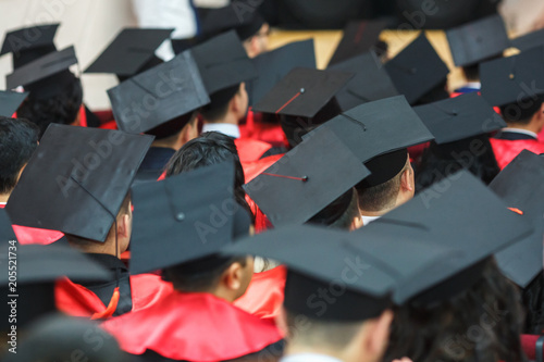 Fotografía Foreign medical students in square academic graduation caps and black raincoats