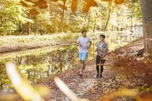 Couple Jogging On Autumnally F...