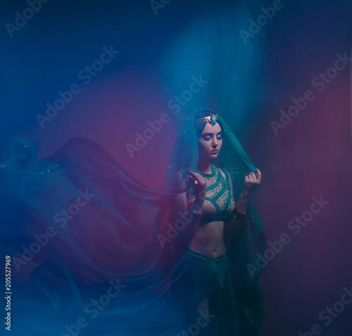 Fotografie, Obraz  A girl in oriental attire, Queen of the storm