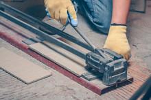 The Tiler Uses Manual Tile Cutter, Finishing Work