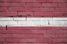 Latvia Flag Is Painted Onto An Old Brick Wall