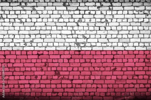 Fototapety Polska poland-flag-is-painted-onto-an-old-brick-wall