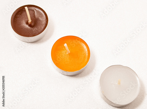 Foto op Plexiglas Chocolade three candles on a white background