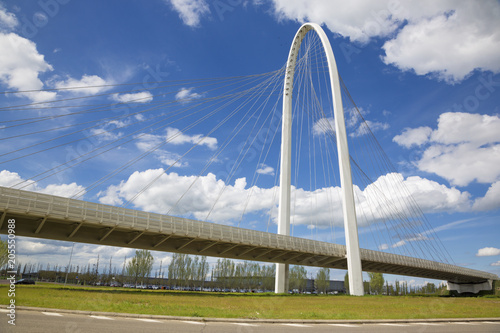 Foto auf Gartenposter Bridges Reggio Emilia - Modern arched bridge by architect Santiago Calatrava
